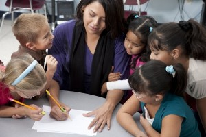 Real People: Teacher with Children in School Education Learning