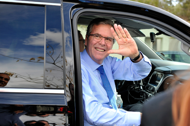 Former Florida Gov. Jeb Bush waves as he departs the Mountain Shadow Community Center in Sun City Summerlin after speaking in Las Vegas Monday, March 2, 2015. (Photo by David Becker/Las Vegas Review-Journal file)