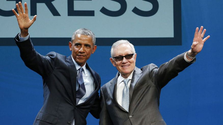 Obama and Reid (Photo by John Locher, Associated Press).