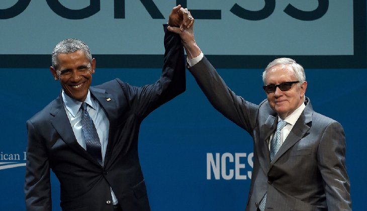 President Barack Obama and Senate Minority Leader Harry Reid  gesture after Obama delivered the keynote address at the National Clean Energy Summit 8.0. (Photo by Ethan Miller, Getty Images)