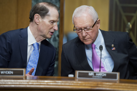 """UNITED STATES - APRIL 21: Sen. Orrin Hatch, R-Utah, chairman of the Senate Finance Committee, talks with Sen. Ron Wyden, D-Ore., ranking member, talk before a hearing in Dirksen Building titled """"Congress and U.S. Tariff Policy,"""" April 21, 2015. Thomas Donohue, president and CEO of the U.S. Chamber of Commerce, and Richard Trumka, president of the AFL-CIO, testified. (Photo By Tom Williams/CQ Roll Call)"""