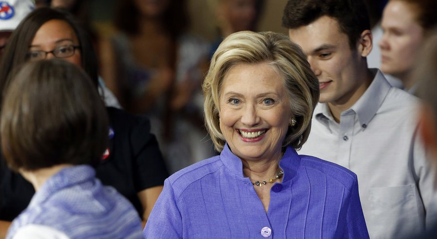 Hillary announces her college degree subsidy program in New Hampshire. In Texas they have a term for that kind of fake grin. (Source: Associate Press)