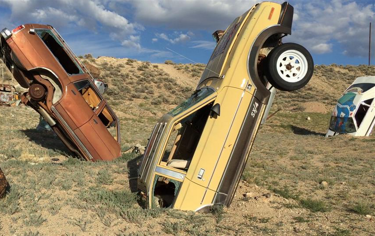 Near the small town of Tonopah, Nevada, sits the International Car Forest of the Last Church -- a dirt lot filled with old cars sticking out of the ground. (Photo by Jim Carlton, The Wall Street Journal)