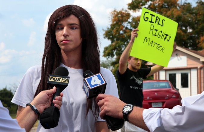 A boy who pretends to be a girl. (Source: Associated Press)