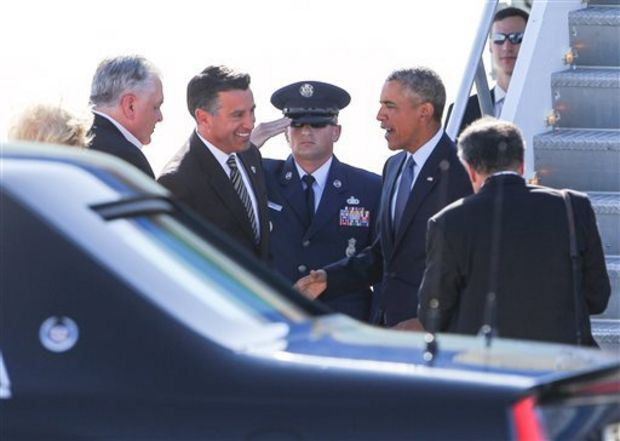 Gov. Sandoval welcomes and greets Pres. Obama when the latter arrives in Las Vegas. (Source: Associated Press)