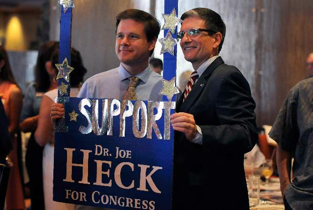U.S. Rep. Joe Heck, R-Nev., right, poses with Ed Williams during the Nevada Republican Men's Club luncheon. (Photo by David Becker, Las Vegas Review-Journal)