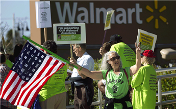 Wal-Mart workers demand higher pay. (Source: Associated Press)