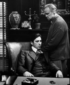 """A scene from the Mafia film """"The Godfather"""" featuring Al Pacino (left) as Michael Corleone and Marlon Brando as Vito Corleone. (Paramount Pictures / Wikipedia)"""