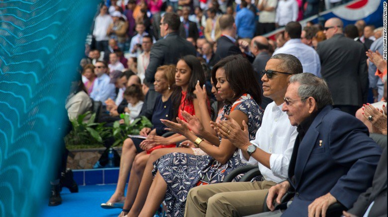 Barack Obama took in a baseball game in Cuba as Brussels mopped up the blood and body parts from terrorist attack