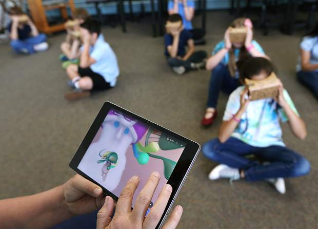 Fourth grade students of Bordewich-Bray and Fremont Elementary experience traveling the world inside their room with Google Expedition Pioneer Program. (Courtesy: Nevada Appeal)